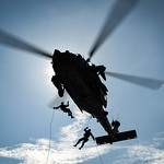 Sailors rappel from an MH-60S Sea Hawk helicopter to the flight deck. thumbnail