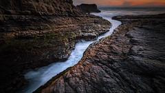 Torn Asunder (PrevailingConditions) Tags: coast ocean rocks sunset ca california bayarea