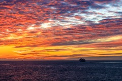 Sail Away - Dover, England (Aethelweard) Tags: dover england unitedkingdom gb sunset spectacular vivid orange blue sea sky ship channel beautiful scenery seaside canon clouds