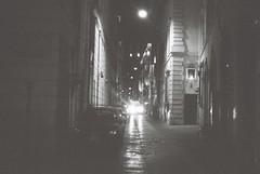 Roma (goodfella2459) Tags: nikon f4 af nikkor 50mm f14d lens ilford delta 400 35mm blackandwhite film analog night roma city buildings street road cars headlights light italy rome bwfp