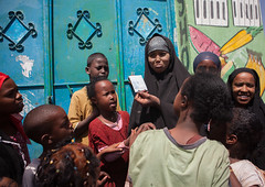 Somali girl discovering her picture on a polaroid, Woqooyi Galbeed region, Hargeisa, Somaliland (Eric Lafforgue) Tags: africa boys capital children curiosity developingcountry disapointed eastafrica girls groupofpeople hargaysa hargeisa hargeysa horizontal hornofafrica islam muslim photography polaroid realpeople soma3414 somalia somaliland woqooyigalbeedregion