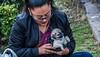 2018 - Mexico City - Mercado del Carmen - 6 of 6 (Ted's photos - For Me & You) Tags: 2018 cdmx cityofmexico cropped mexicocity nikon nikond750 nikonfx tedmcgrath tedsphotos tedsphotosmexico vignetting dog glasses female lips redlips strap eyelashes eyebrows face portrait zipper paws hands