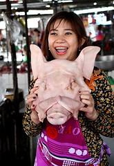 A vietnamese market girl proudly shows off a fresh Pig's head. (One more shot Rog) Tags: vietnam vietnamese markets market selling onemoreshotrog travel nikond500 meat fruitandveg pig pigshead shopgirl butchers buther meatmarket