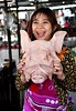 A vietnamese market girl proudly shows off a fresh Pig's head. (One more shot Rog) Tags: vietnam vietnamese markets market selling onemoreshotrog travel nikond500 meat fruitandveg pig pigshead shopgirl butchers buther meatmarket