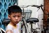 A child at the My Tho market, Vietnam (Roberto Bendini) Tags: bicycle child market river mekong mytho vietnam hanoi ho chi minh saigon