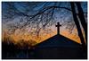Sunrise in St. Bernard's Cemetery (Rick Olsen) Tags: dawn cross cemetery morning silhouette fuji fujifilm xt2 watertown wisconsin