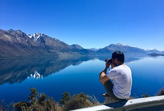 Photography Perks (Alfredo Esing) Tags: thegreatoutdoors nz newzealand new zealand southisland queenstown lakewakatipu lake water photographer photog view nature still reflections sky mountians stop mountian snow sbowcaps roadtrip wonderlust