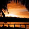 Sunset sur le 1er motu du Club Med depuis la plage de Moemoea à Moorea (Christian Chene Tahiti) Tags: olympus c2000z moorea haapiti ponton motu plage silhouette ombre sableblanc mer extérieur lagoon lagon cocotier palme pf polynésie française frenchpolynesia couleur color sunset coucherdesoleil orange noir gris jaune sky ciel soir lumière sunlight bleu crépuscule nuage cloud sun