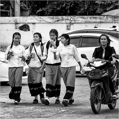 School's out (John Riper) Tags: johnriper street photography straatfotografie square vierkant bw black white zwartwit mono monochrome chiangmai thailand candid john riper xt2 fujifilm xf 18135mm schoolgirls moped motor bike woman drinks straws uniform school