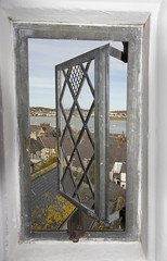 Through the leaded window (rhianwhit) Tags: window view estuary conwy frame cadw roof town water open ajar leaded pane glass old architecture