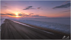 A Peaceful Sunset (Moe Ali Photography) Tags: sunset beautifulsunset serene peaceful calm relaxing colorful road trail path backroad country snow snowfields landscape nature outdoors outdoorphotography moealiphotography pointandshoot alberta clouds sunrise gravel horizon glow glowing cloudy winter cold travel