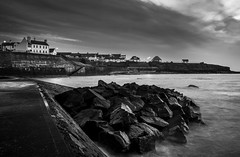 The Seawall (daveharman70) Tags: white house rocks whitehouse historic history smugglers england pier coast cullercoats morning early water sea ocean still calm landscape seaside seascape blackandwhite bw cliffs weather streetlights moody north northern northumberland tyneside northeast beach seawall waves