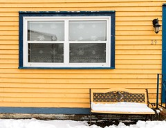 Waiting for Summer (Karen_Chappell) Tags: house window yellow nfld thebattery stjohns architecture bench seat paint painted wood wooden clapboard newfoundland canada atlanticcanada avalonpeninsula snow city blue trim