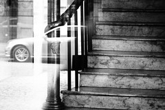 In and out of Hotel Europe (Eric Flexyourhead) Tags: vancouver canada britishcolumbia bc gastown powellstreet hoteleurope city urban detail fragment stairs staircase marble stone window glass reflection reflections layers monochrome blackwhite bw artfilter grainyfilm olympusem5 mzuikodigital45mmf18 45mm zd