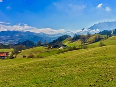Bavarian landscape with the Alps near Oberaudorf, Germany (UweBKK (α 77 on )) Tags: landscape scenery panorama view bavaria oberaudorf alps fields green trees sky blue germany deutschland bayern europa europe iphone