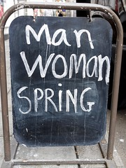 Man Woman Spring (the justified sinner) Tags: justifiedsinner sign man woman spring brighton eastsussex panasonic 17 20mm gx7