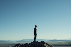 Alone in the blue summit (josemanuelerre) Tags: mountain peak landscape portrait sky earth nature minimalism backlight male man young explorer top rock epic up travel tourism experience clear day light blue dark horizon natural explore stone mountainous discover country outdoors border newzealand loneliness beauty empty think scene meditation summit tiny cap view solitude