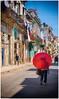 Red Umbrella (kurtwolf303) Tags: 2015 cuba lahabana umbrella sonnenschirm strase streetphotography strasenfotografie kuba karibik caribbean buildings gebäude rot red people olympusem5 omd microfourthirds micro43 systemcamera mirrorlesscamera mft kurtwolf303 spiegellos urban unlimitedphotos topf25 topf50 topf75