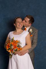 Wedding Day Poses (aaronrhawkins) Tags: wedding bride groom couple blushing kiss pose laura trevor flowers dress orange white studio aaronhawkins