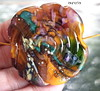 Lauretta (Laura Blanck Openstudio) Tags: openstudio openstudiobeads glass handmade lampwork beads murano single focal bead necklace pendant jewelry abstract asymmetric colorful multicolor earthy organic big huge holes whimsical funky odd fine arts artist artisan made usa transparent frit sterling silver silvered speckles shiny flat wearable nugget swirl spiral urchin amber maize yellow ocher orange coral brown raku honey caramel green teal emerald pink lilac lavender purple grape eggplant plum violet bold contemporary