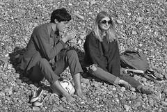 Brighton Beach: Time for a smoke... (markwilkins64) Tags: streetphotography street candid brighton beach pebbles shingle rocks man woman couple seaside smoke smoking sunshine bright sunglasses blonde feet cigarette sussex uk