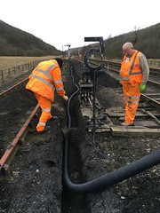 Andy and Michael lay duct past ground frame 19Mar18