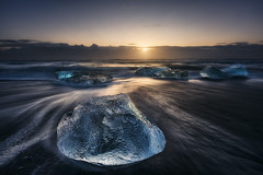 Diamond Beach (Manuel.Martin_72) Tags: iceland diamondbeach jokulsarlonglacierlagoon drama enchanting lightdrama magic ice iceblocks stones reflections sea water waterreflections clouds cloudy glow sun sunrise morning waves sand wbpa