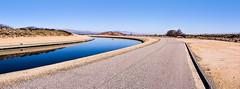 Aqueduct Sharp Turn (joe Lach) Tags: antelopevalley california fairmont blue brown californiaaqueduct flowingwater joelach mohavedesert mojavedesert river runningwater stream gravitydriven sharpturn paved road bluesky