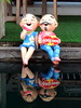 Couple (markb120) Tags: water aqua backwash vacuity reflection repulse reflexion image mirror reflex doll puppet dummy poppet statuette figurine couple pair garden yard grounds garth pond pool impoundment mere laguna stank