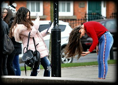 Let your hair down (* RICHARD M (Over 7 MILLION VIEWS)) Tags: street candid tourists teenagers teens adolescents adolescence fun happy happiness longhair smiles girlsjustwannahavefun liverpool merseyside jeans denims brunettes skinnyjeans tightjeans shoulderbag pufferjackets pinkpufferjacket badhairday redsweater redjumper girlfriends redwhiteandblue bowedhead laidback cameraphones photographers togs students bluejeans denimjeans lol thedecisivemoment