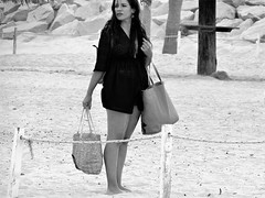 Time to leave (thomasgorman1) Tags: monochrome woman baja beach sand swimwear canon candid streetphotos streetshots bw looking outdoors resort streetportrait