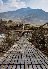 Suspension Bridge (MashrikFaiyaz) Tags: bhutan landscape asia southasia punakha dzong flickrunitedaward travel tourism bridge suspension river chhu mountain hills skyline cloud clouds blue sky white nature natural beauty view february winter spring world exploration heritage architecture iron design cityscape architectural urban town village