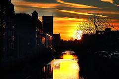 Fire Fire Fire (Idreamofpies) Tags: chester cheshire uk england gb great britain canal waterway shropshire union architeture miln seeds water sunset sundown silhouette reflection yellow orange endoftheday sky clouds city cityscape