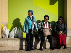 """This one's ours ... "" (Canadapt) Tags: women waiting shadows shopping three street busstop loures portugal canadapt"