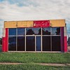 Highway 61 Bar & Grill (ADMurr) Tags: clarksdale ms highway 61 bar grill frontal window clouds grass path rolleiflex 28f 80mm zeiss planar kodak ektar late afternoon dab1762edit2 clover sign sky yellow red blue