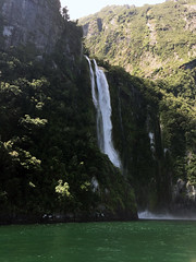 Milford Falls (syf22) Tags: kiwi maori downunder newzealand milfordsound mountain hill rocky southernalps mountainrange tall high water green tree scenic view open countryside opencountry vast plain waterfalls falls downrush drop cliff channel navigation shipping fjord inlet narrow creek estuary firth rivulet strait stream tributary alp dome peak elevation height hump mass mound mount pike range sierra tor