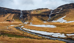 Twice was ice (Ron Jansen - EyeSeeLight Photography) Tags: iceland winter spring falls two ice creek stream depth clouds cloudy farm red orange grass dead water waterfall cliff mountain mountains snow