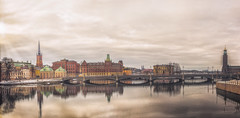 A Unique Perspective of Stockholm's Old Town (S.A.W. Pixels) Tags: architecture architectural art stockholm panaroma panaromic building buildings cityscape canon clouds dramatic darkclouds frozen balticsea baltic sea excellent europe exciting nordic sweden history heritage historical landscape landmark monument outdoor observing outside picture photo peace water white snowing frozenwater city sky snow boat warmsunset