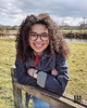 The Great Outdoors (Colour) (malikhahmed) Tags: aysha fashion nature naturalhair curly natural curlyhair green red blue brown glasses denim jacket watch cumbria longtown model girl woman smile pose happy hair grass face