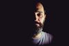 Half (theoswald) Tags: self shadows selfportrait autoretrato people eyes moody darkness 35mm beard light