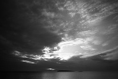 Of sunsets over islands... (Nikos.K.) Tags: 2018 greece voula sea sky island sunset clouds blackandwhite film 135 bw fp4125 expiredfilm homebrewdeveloper d76 olympusom2n zuiko 50mm18