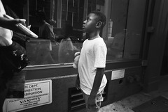 A Scolding (Brian Gilbreath) Tags: ifttt 500px man leader three woman two four commerce group administration outfit outerwear guy street photography streets streetphotography people life new york city film 35mm black white bw family argument