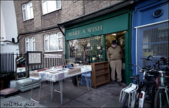 `2212 (roll the dice) Tags: london se1 southwark man shops shopping bargain sale closed vanished lonely sad mad bored streetphotography rubbish antiques price colour shopfront urban england classic uk art people natural unaware unknown portrait stranger candid tourism tourists fuji hat windows glass reflection wish bicycle flats life wisdom bygone retro old room surreal 2011