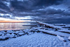 Winter Sunrise (Paul Rioux) Tags: nature scenic seascape seashore waterfront beach winter snow snowfall cold ice frost driftwood calm water sea ocean reflection sky morning daybreak sunrise clouds colour outdoors prioux esquimaltlagoon colwood westshore rock blue