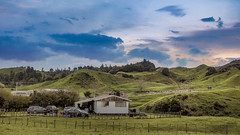 Countryside New Zealand (autumn_leaf) Tags: newzealand okerefalls sunset farm dramaticsky rollinghills