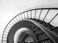 Spiraling Down (mjhedge) Tags: getolympus olympus oly em1mkiiomdem1markii omdem1mkii omd 714mm 714 m714f28pro mzuiko714mmf28pro lighthouse staugustine stairs steps staugustinelighthouse blackandwhite bw blackwhite monochrome abstract