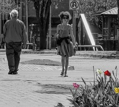 Spring is in the Air (clarkcg photography) Tags: man woman street pass passby walk spring music dress okc oklahomacity bricktown bw color tulips