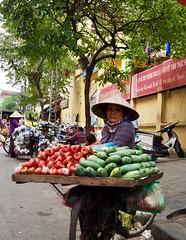 Street vendor in Hanoi (Hammerhead27) Tags: market happy colours vietnam hanoi woman bicycle vegetables selling seller street