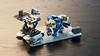 Mad Bomber (Joe Gan) Tags: lego nexo mecha mech robot moc blue toy hangar