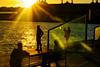 Sunset activities (Fnikos) Tags: port porto puerto harbour harbor sun city architecture sea water waterfront sky skyline rays sunset bench people outdoor